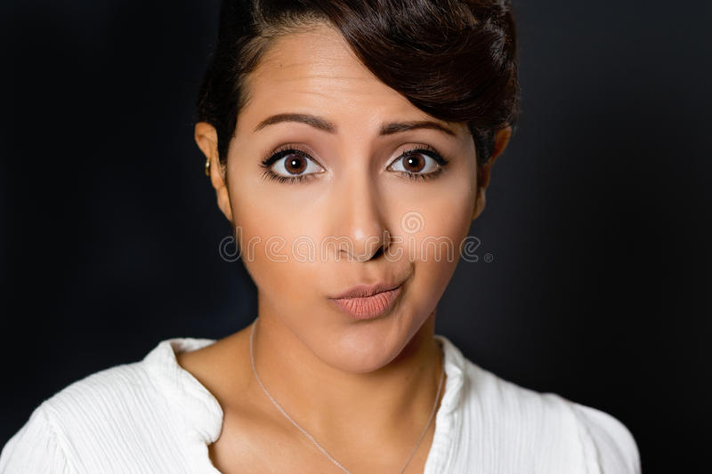 Crooked Smile Woman. Beautiful woman with crooked smile expression royalty free stock photo