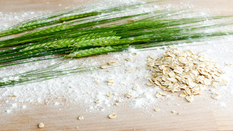 Crop barley with plain flower and oats - healthy eating concept stock images