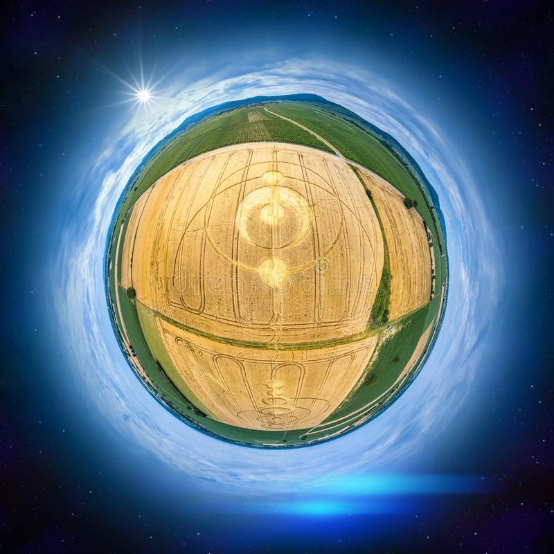 crop circles at Alsace France as a little planet panorama stock photos