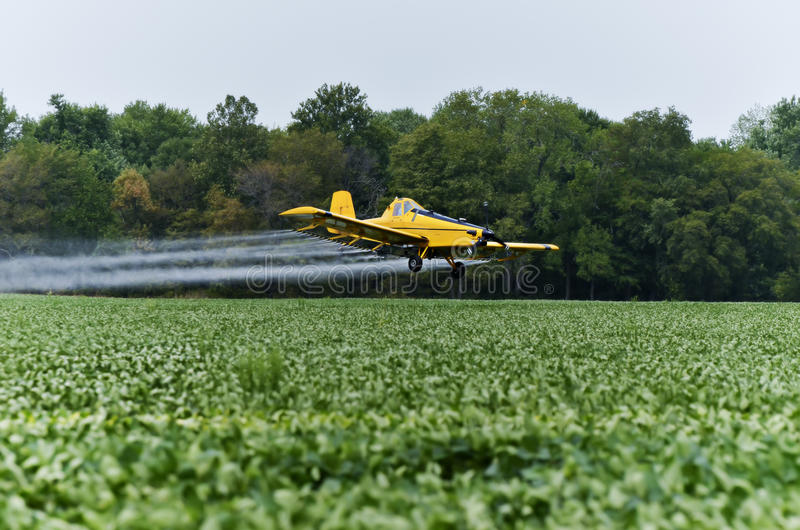 Crop duster. Flying in the fields of Illinois royalty free stock images