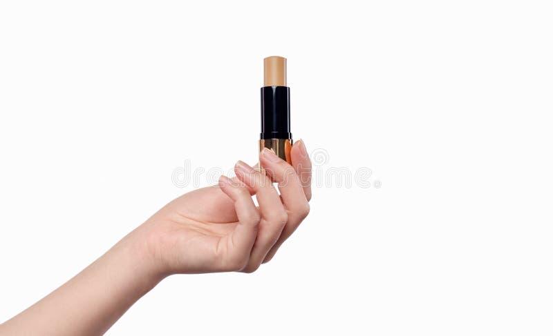 Crop hand with beige lipstick stock photos