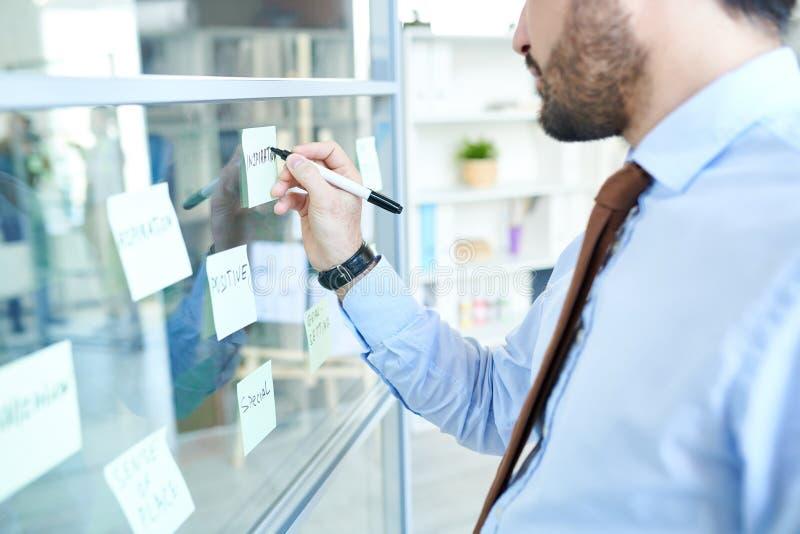 Crop man arranging sticky notes stock photos
