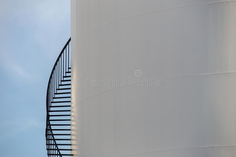 Crop of oil storage - oil terminal. On the blue sky for background stock photos