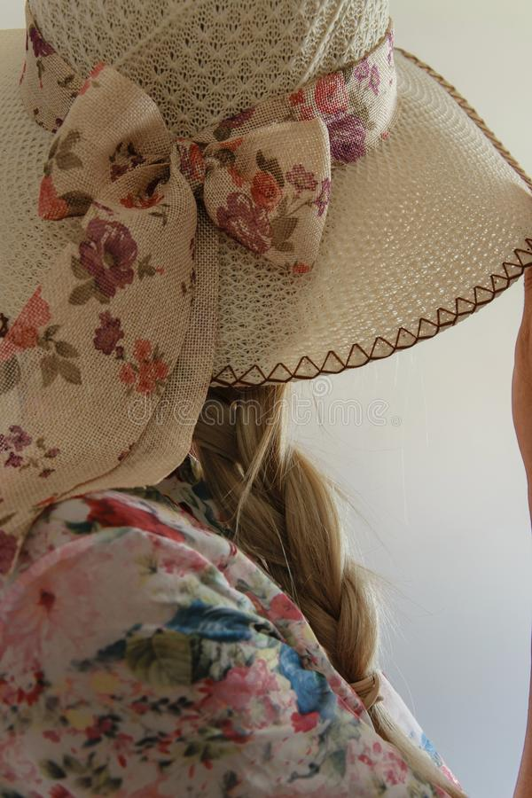 Crop view of attractive blond woman with elegant summer hat royalty free stock photography
