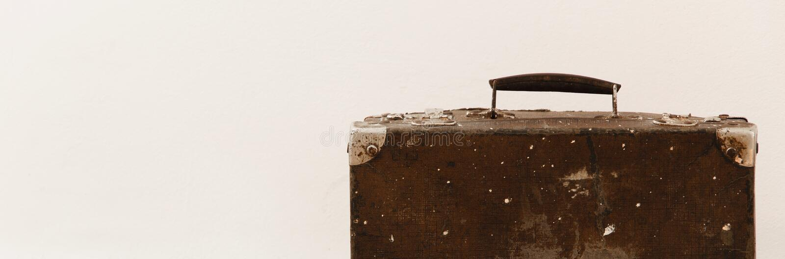 Crop view of isolated vintage suitcase on white background stock image