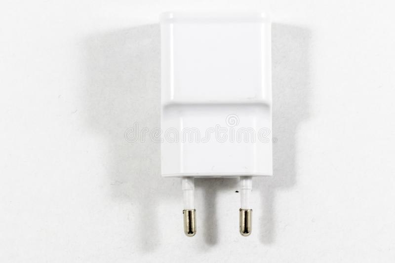 Cropped clear shoot of white colored mobile phone charge adapter royalty free stock image
