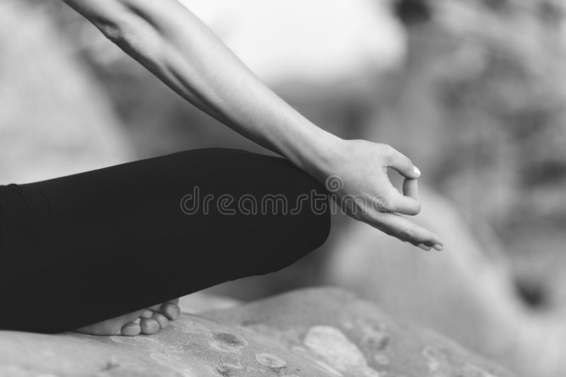 Young woman practicing yoga outdoors royalty free stock image
