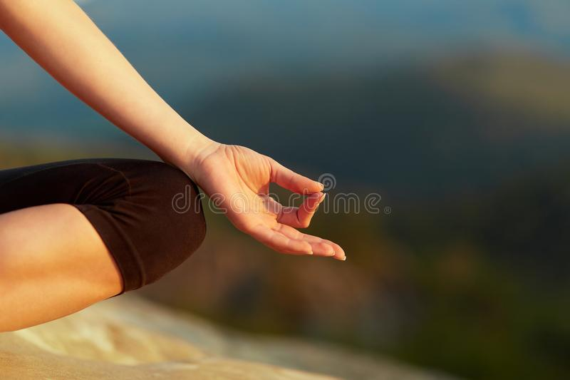 Young woman practicing yoga outdoors royalty free stock photography