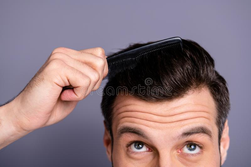 Cropped close up photo amazing he him his macho hands arms plastic hair styling brush take care hairdo barber shop. Cropped close up photo amazing he him his royalty free stock images