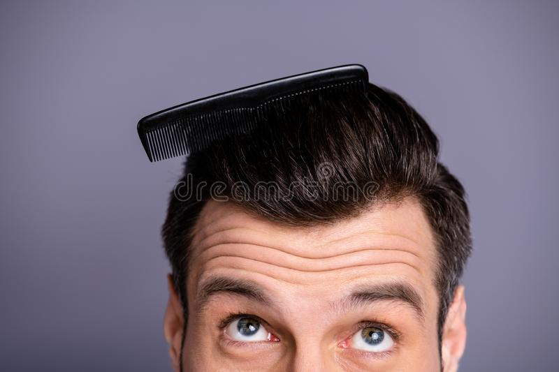 Cropped close up photo amazing he him his macho plastic styling brush stuck thick hair oh no take care hairdo barber. Cropped close up photo amazing he him his royalty free stock photos