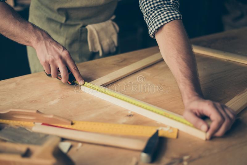 Cropped close up photo of cabinet-maker`s strong hands, the mast stock photography