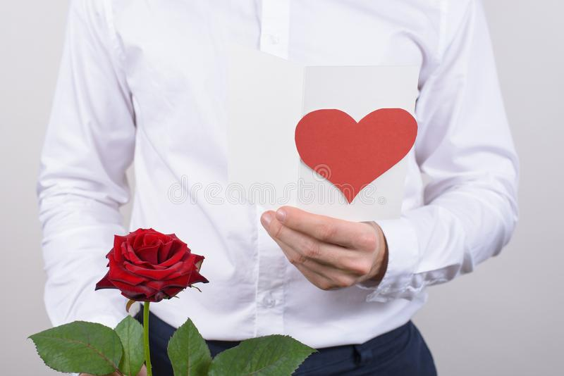 Cropped close up photo of cheerful handsome smiling sincere falling in love guy opening his heart to beloved lady reading poem stock photo