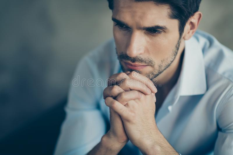 Cropped close up photo of pensive troubled businessman sit chair touch his chin wait for decide choose choice feel stock image
