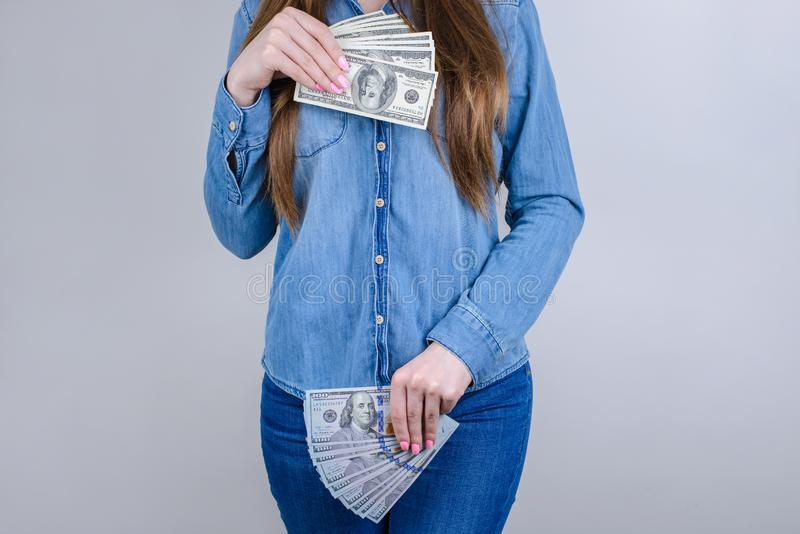 Cropped close-up photo portrait of confident concentrated she her lady covering closing places on body with pile stack of money stock image