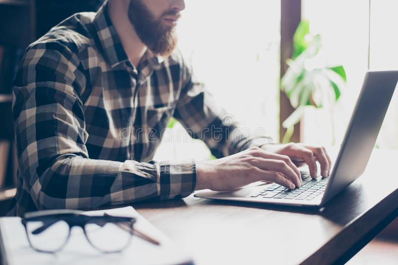 Cropped close up photo of serious concentrated handsome confident busy red bearded guy, hands fingers typing email on laptop royalty free stock photos