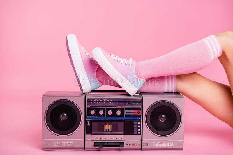 Cropped close up photo skinny perfect ideal she her lady legs lying near boom box play on fitness training workout press. Swing happy glad be in fit soundtrack royalty free stock image