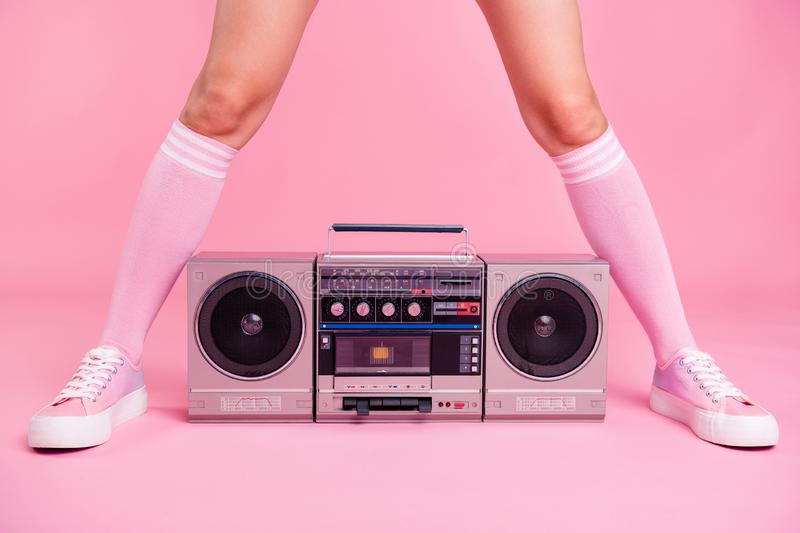 Cropped close up photo skinny perfect ideal she her lady legs opposite standing boom box play between teens hanging out. Celebrating weekend holiday pink rose royalty free stock images