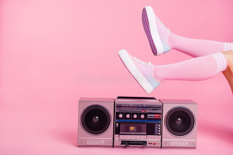 Cropped close up photo skinny perfect ideal she her lady legs raised up lying near boom box playing fitness training. Workout press swing happy soundtrack stock photos