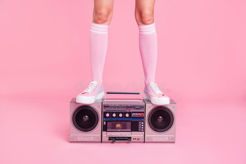 Cropped close up photo skinny perfect ideal she her lady legs standing on boom box play fitness coach happy glad see new. Members of fit life team soundtrack stock photos