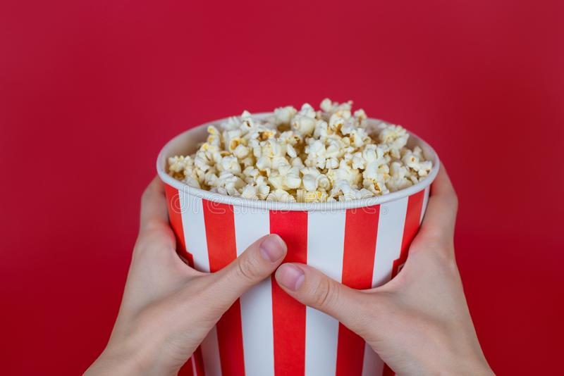 Cropped close-up top above overhead high angle view photo of tasty yummy delicious fresh container with popcorn isolated bright. Background royalty free stock photo