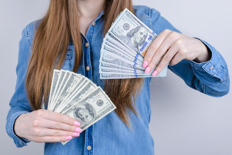 Cropped closeup photo view of happy satisfied charming beautiful she her lady boasting piles stacks of money in hands wearing stock images