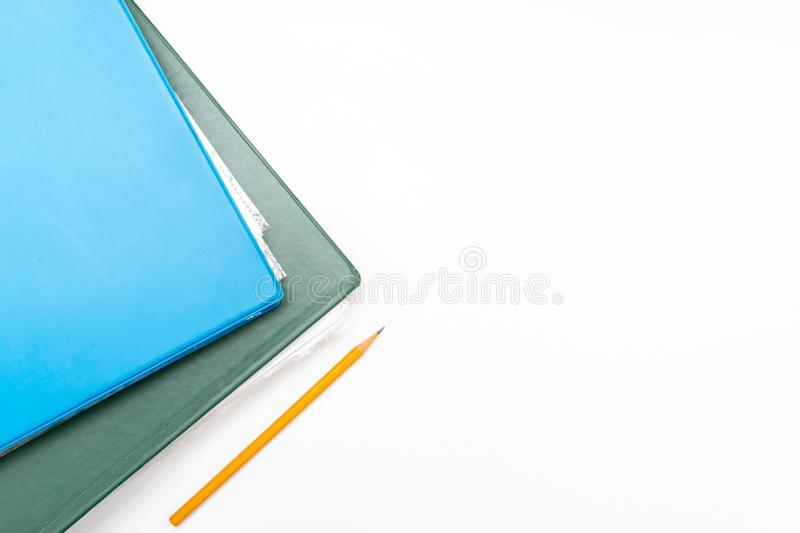 Cropped colorful folders with documents and bills on white table with copy space stock images