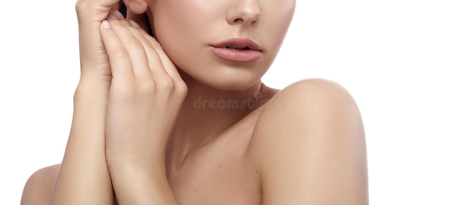 Cropped frontview of model touching her face and neck tenderly. stock photo