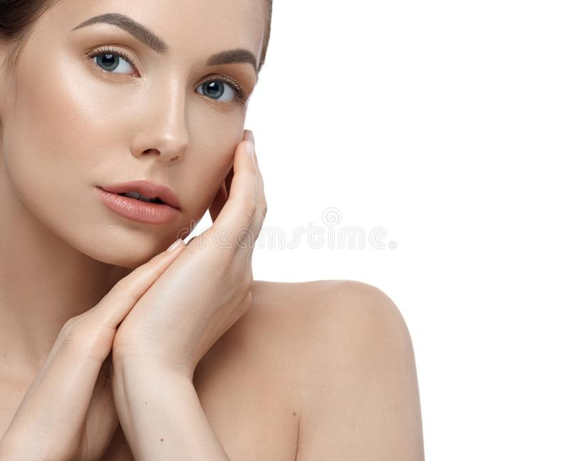 Cropped frontview of woman looking at camera touching her face. royalty free stock image