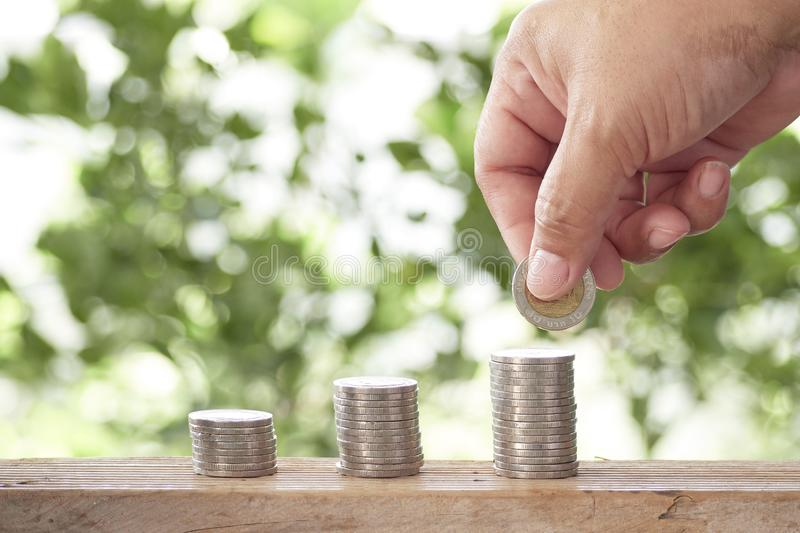 Cropped Hand Stacking Coins stock image