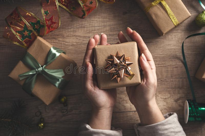 Cropped hands of woman holding Christmas present stock image