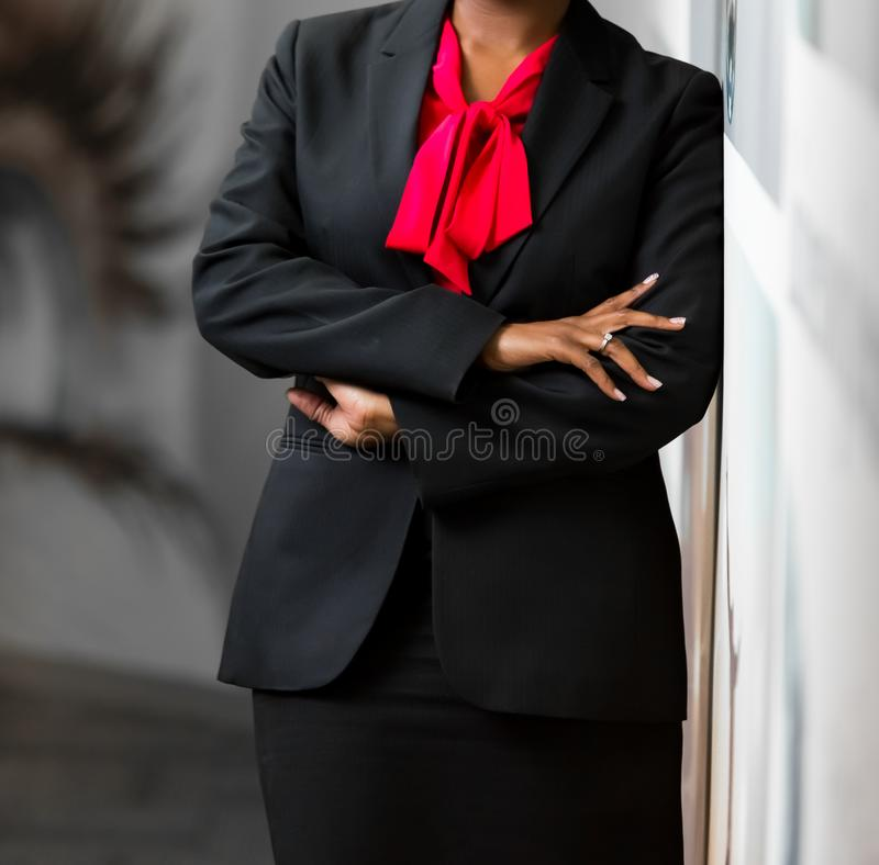 Cropped head African Business Woman in corporate attire. With arms folded royalty free stock photo