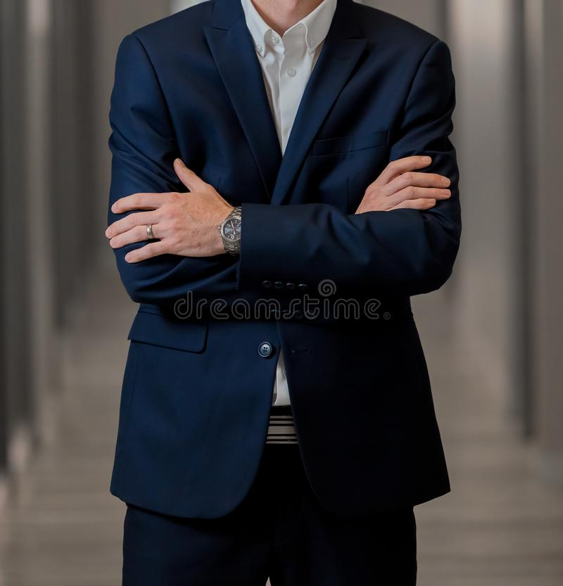 Cropped head Man standing in a smart suit with folded arms. Cropped head Man standing in a smart suit with arms folded stock photos