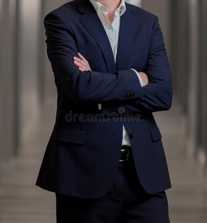 Cropped head Man standing in a smart suit with folded arms. Cropped head Man standing in a smart suit with arms folded stock image