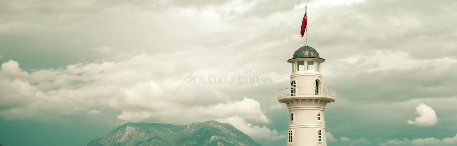 Cropped horizontal image lighthouse on cloudy sky royalty free stock images