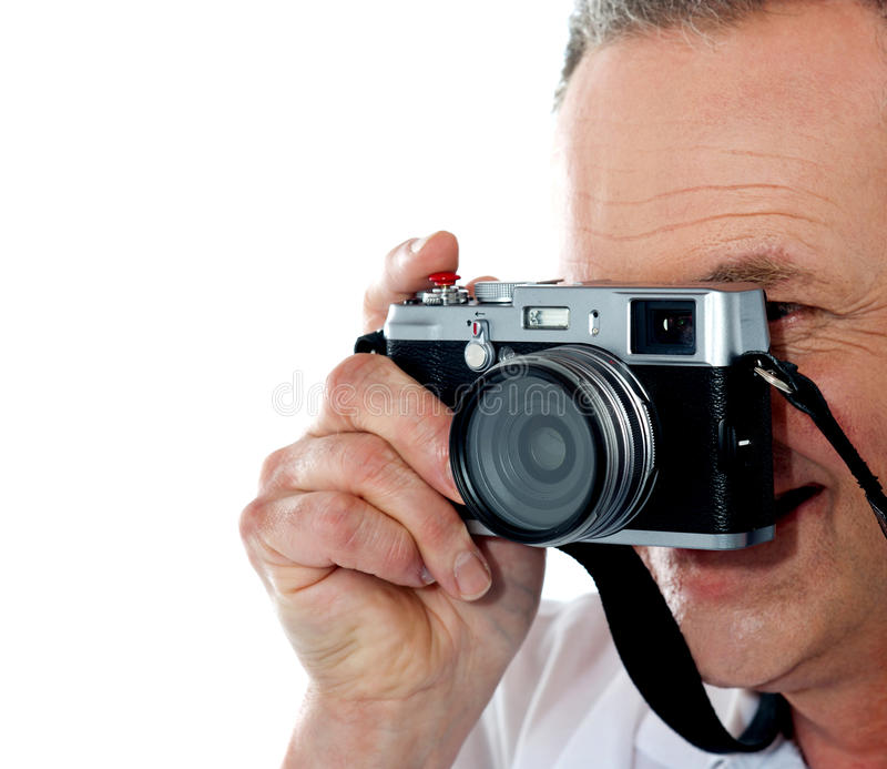Cropped image of aged male photographer royalty free stock photo