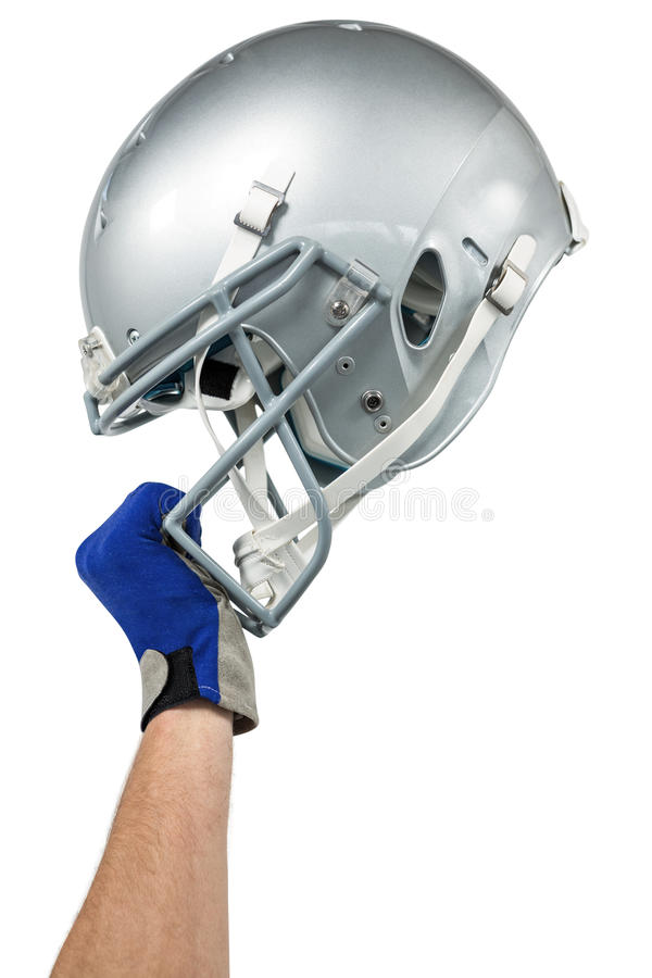 Cropped image of American football player handing his helmet stock images