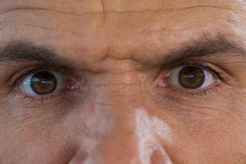 Cropped image of angry mature man stock images