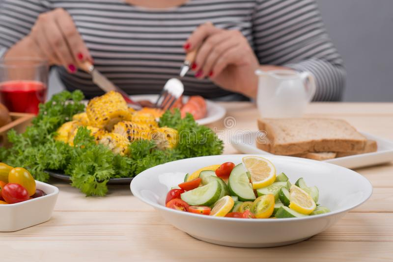 Cropped image of asian woman have breakfast stock image