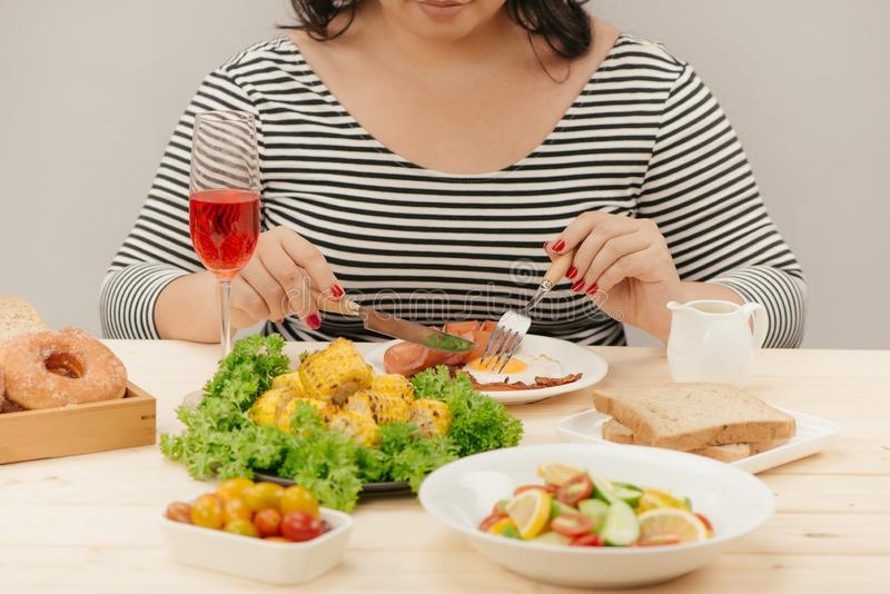 Cropped image of asian woman have breakfast stock photo