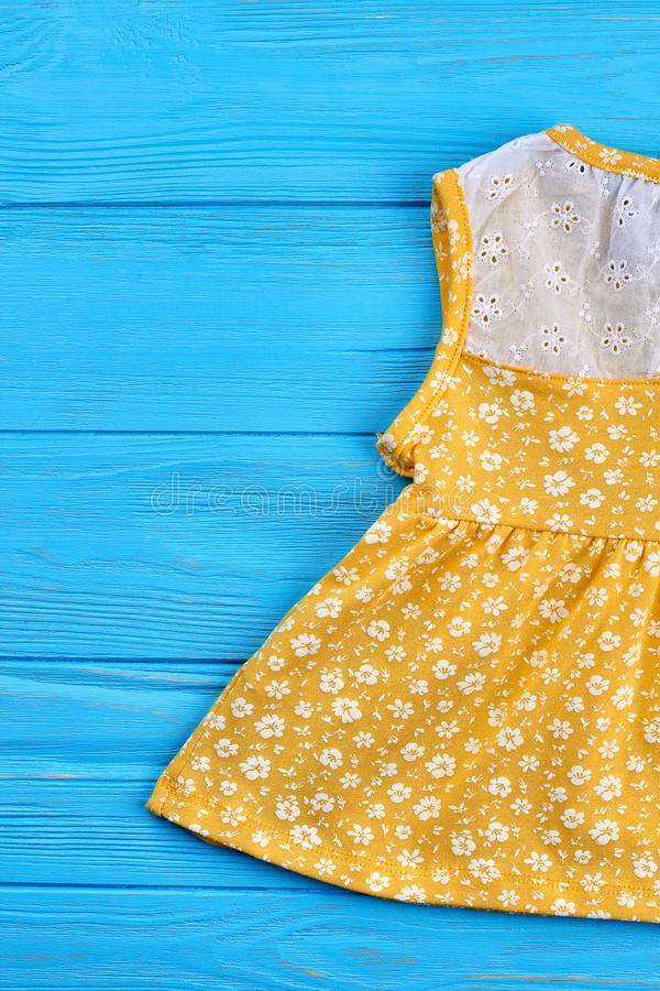 Cropped image of baby yellow dress. stock photo
