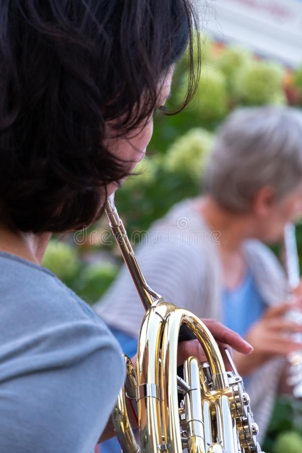 German horn player stock photo