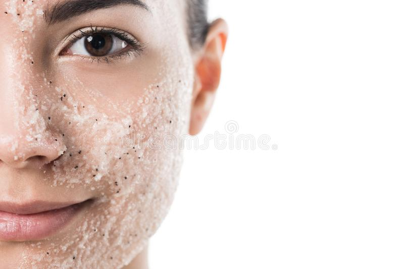 Cropped image of beautiful girl with facial scrub looking at camera. Isolated on white royalty free stock photos