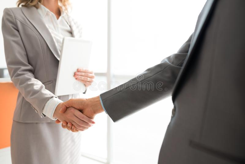 Partnership. Cropped image of business executives shaking hands to greet each other stock photography