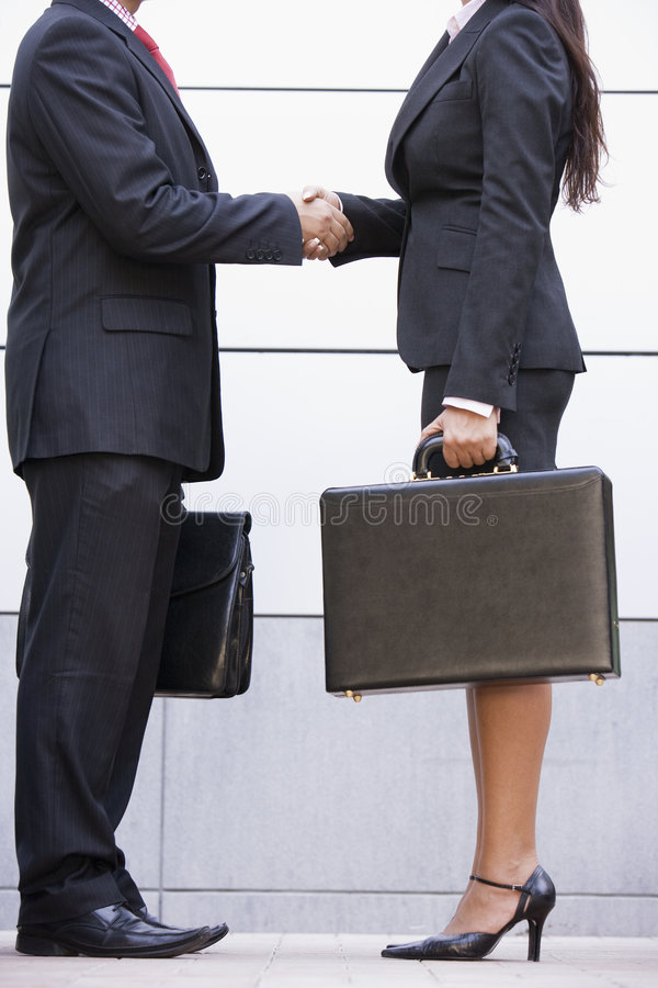 Cropped image of business meeting outside office. Cropped image of business meeting outside modern office stock photography