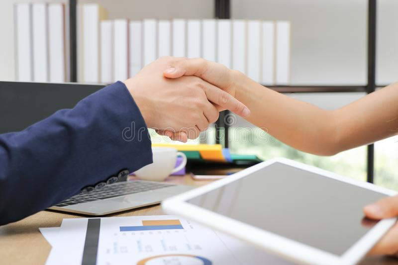 Cropped image of business people shaking hands with partners after finishing a meeting. Handshake greeting deal concept.  stock image