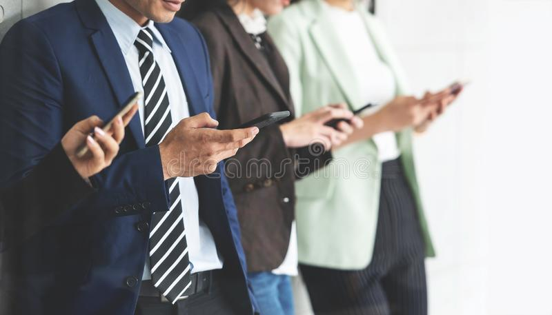 Cropped image of Business people using smartphones. stock photography
