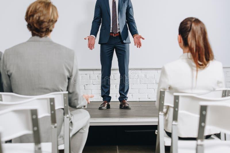 cropped image of business trainer showing shrug gesture stock illustration