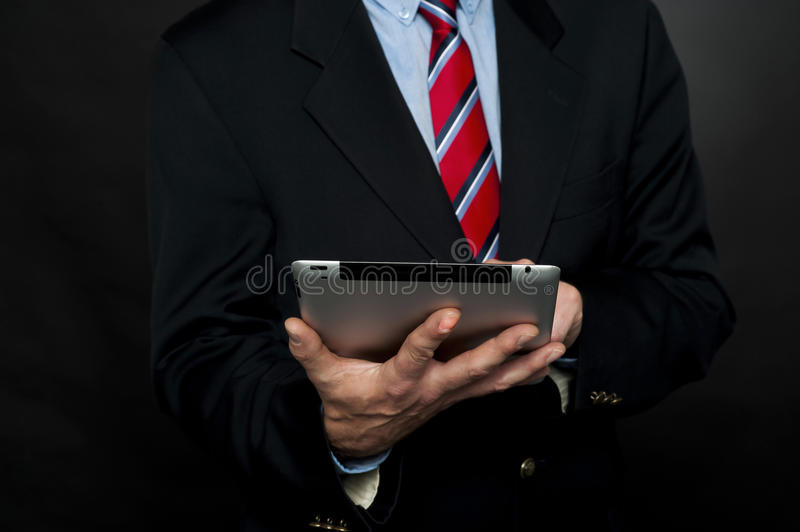 Download Cropped Image Of Businessman Browsing Tablet Pc Stock Photo - Image of modern, corporate: 26567062
