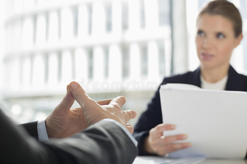 Cropped image of businessman in meeting with colleague at office cafe royalty free stock photos