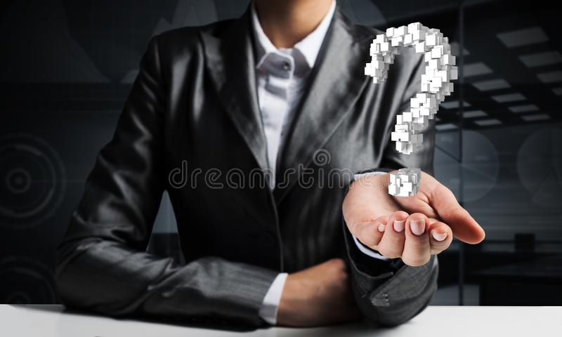 Businessman presenting question mark. Cropped image of businessman in suit presenting multiple cubes in form of question mark in his hand. 3D rendering stock images